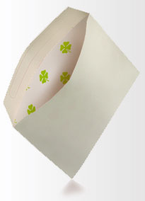 Homemade envelope with four leafed clover pattern inside